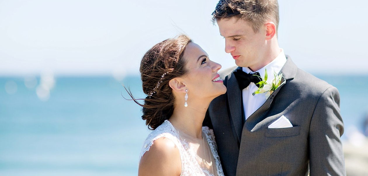 Brunette Bride with Headband Updo in Wedding Day Photos by Ocean. Bridal Hair and Makeup by Vanity Belle in Orange County (Costa Mesa) and San Diego (La Jolla)