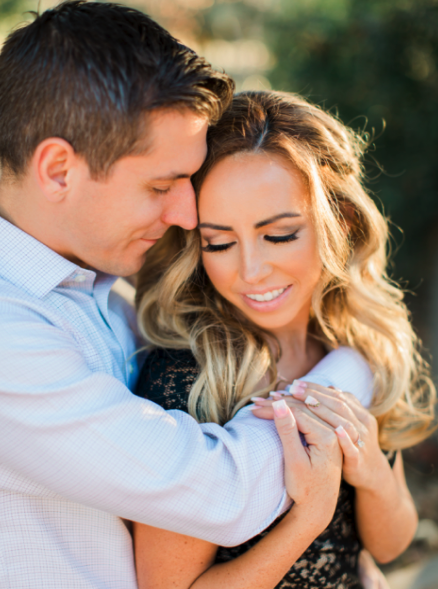 Engagement Photos Couples Posing and Hugging. Hair and Makeup done by Vanity Belle in Orange County (Costa Mesa) and San Diego (La Jolla).