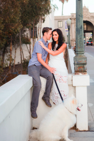 Engagement Photo with Couple Posing with Dog in City. Hair and Makeup done by Vanity Belle in Orange County and San Diego.