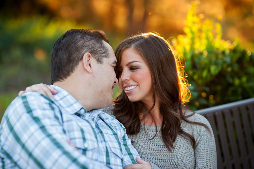Romantic Engagement Photos with Couple Looking into Eyes. Hair and Makeup done by Vanity Belle in Orange County (Costa Mesa) and San Diego (La Jolla).