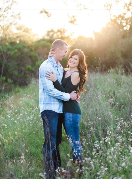 Engagement Photos in Nature with Couple Hugging and Smiling. Hair and Makeup done by Vanity Belle in Orange County (Costa Mesa) and San Diego (La Jolla).