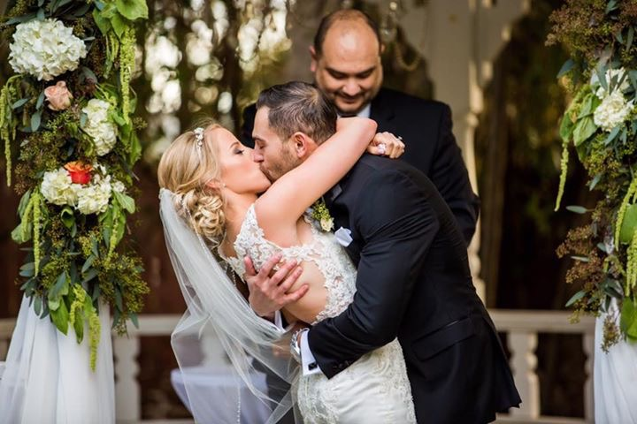 Wedding Photography with Husband & Wife Kissing. Bridal Hair and Makeup by Vanity Belle in Orange County (Costa Mesa) and San Diego (La Jolla)