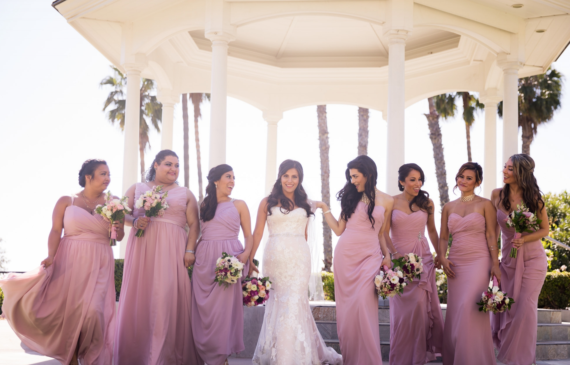 Multicultural Wedding with Bridal Party Posing in Pictures
