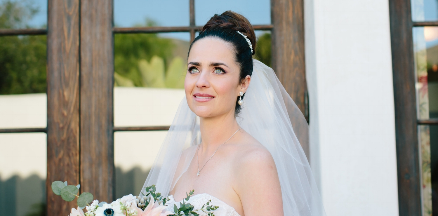 Brunette Bride with Braid Updo and Veil + Makeup for Blue Eyes. Bridal beauty by Vanity Belle in Orange County (Costa Mesa) and San Diego (La Jolla)
