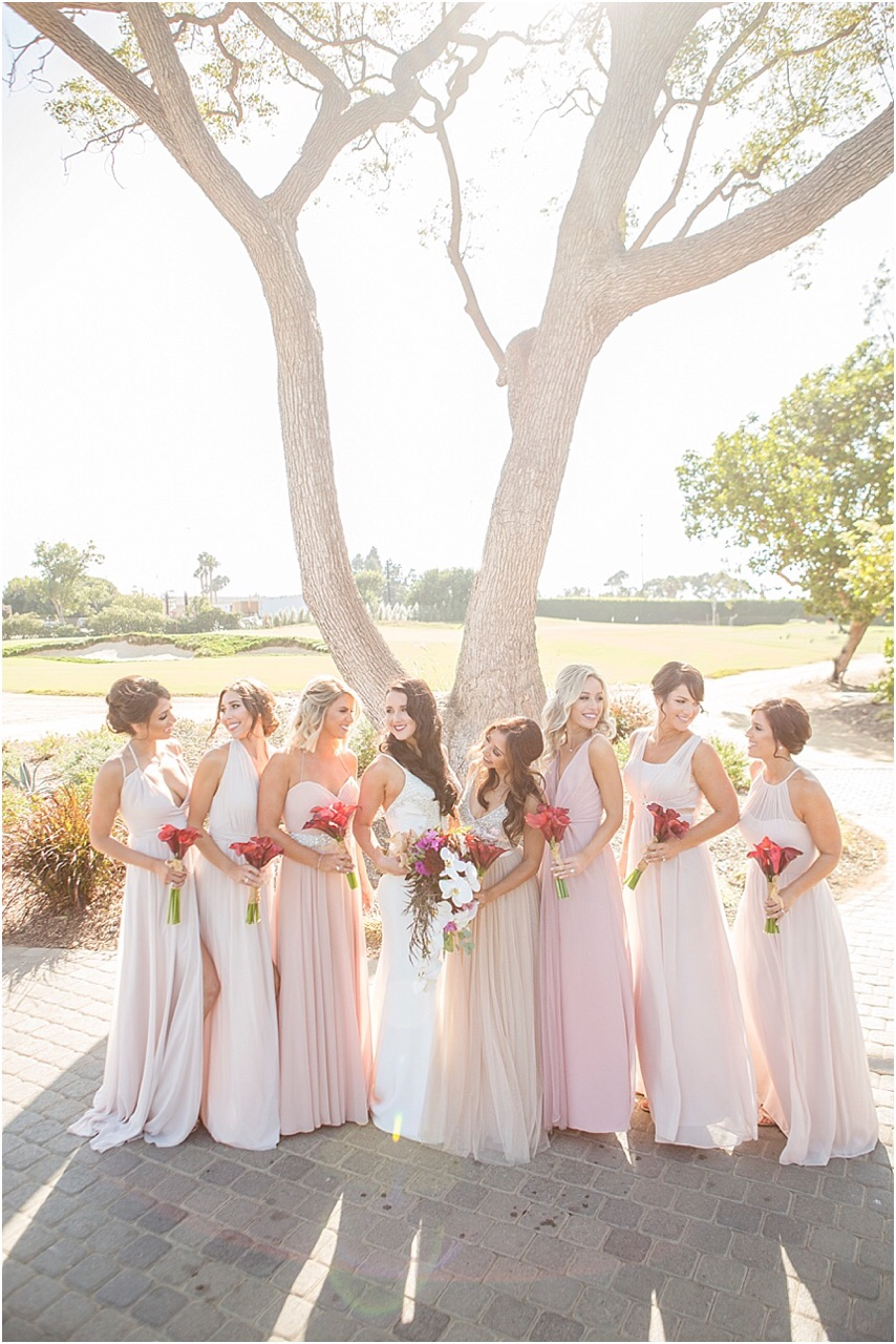 Pretty in pink is an understatement when describing this gorgeous bridal party. Mismatched bridesmaid dresses are the new way to make your bridesmaids stand out, according to  The Knot.
