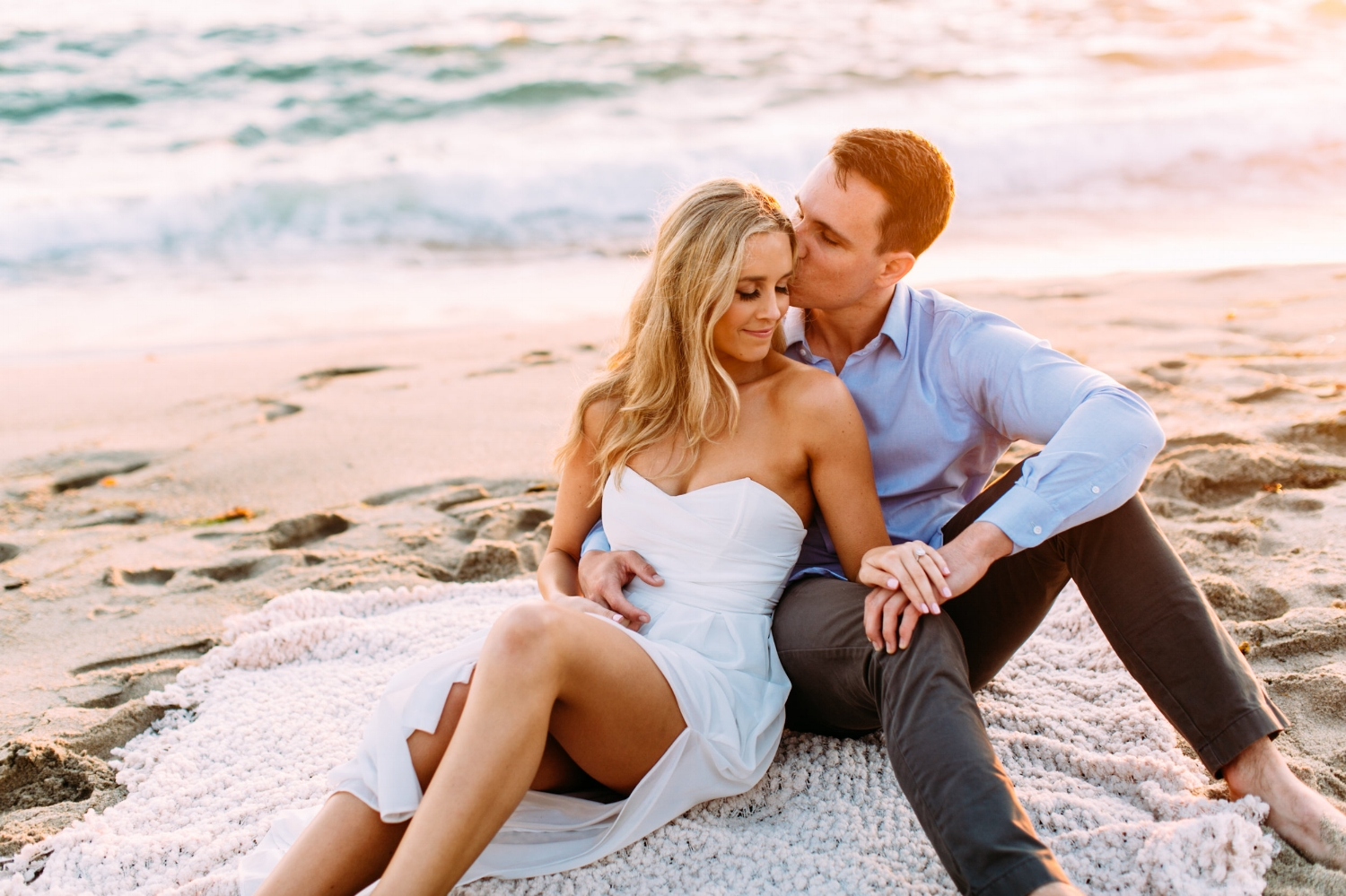 Engagement Picture Poses at Beach. Hair and Makeup done by Vanity Belle in Orange County (Costa Mesa) and San Diego (La Jolla).