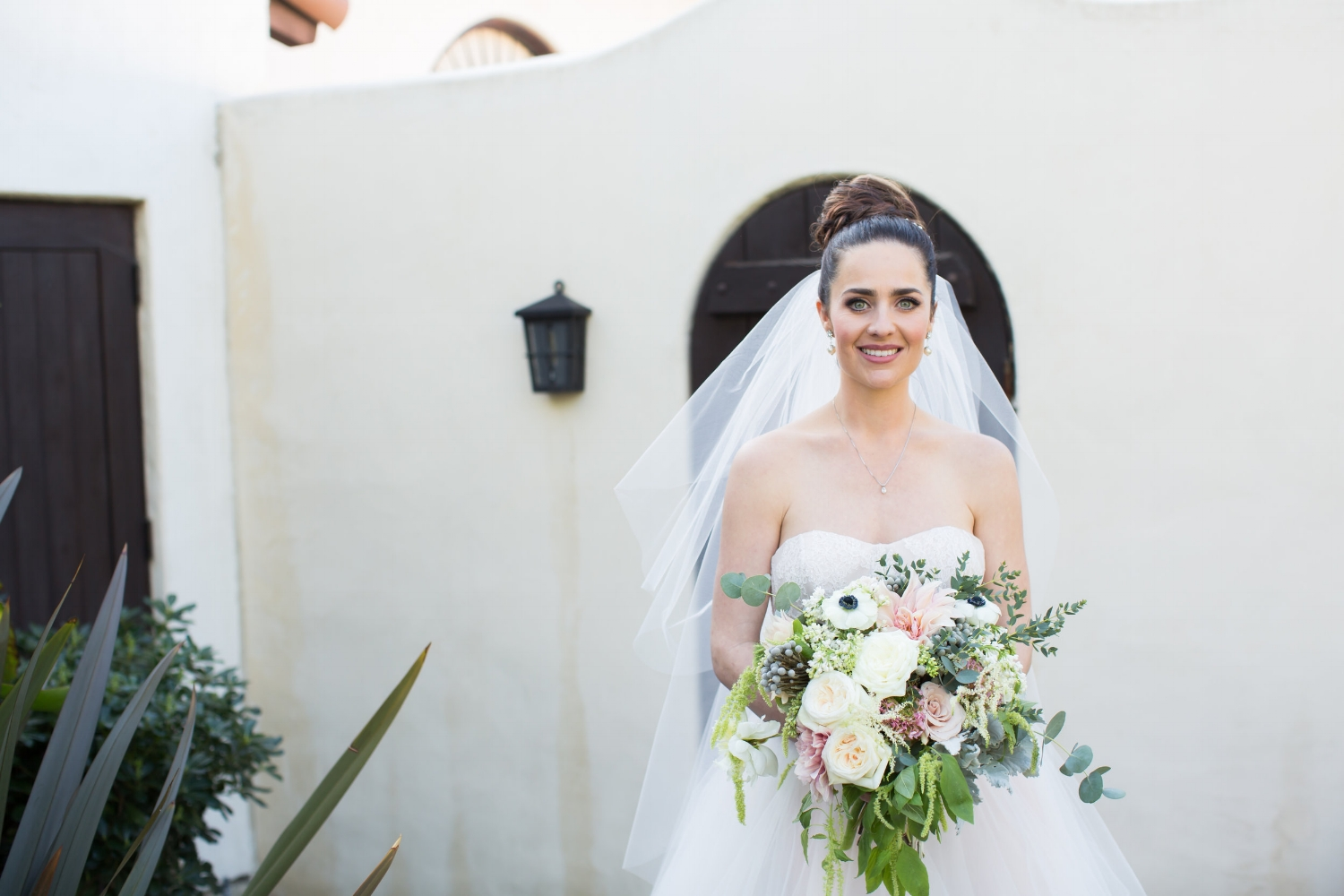 Brunette Bride with Braid Updo and Bouquet. Wedding Hair and Makeupby Vanity Belle in Orange County (Costa Mesa) and San Diego (La Jolla)