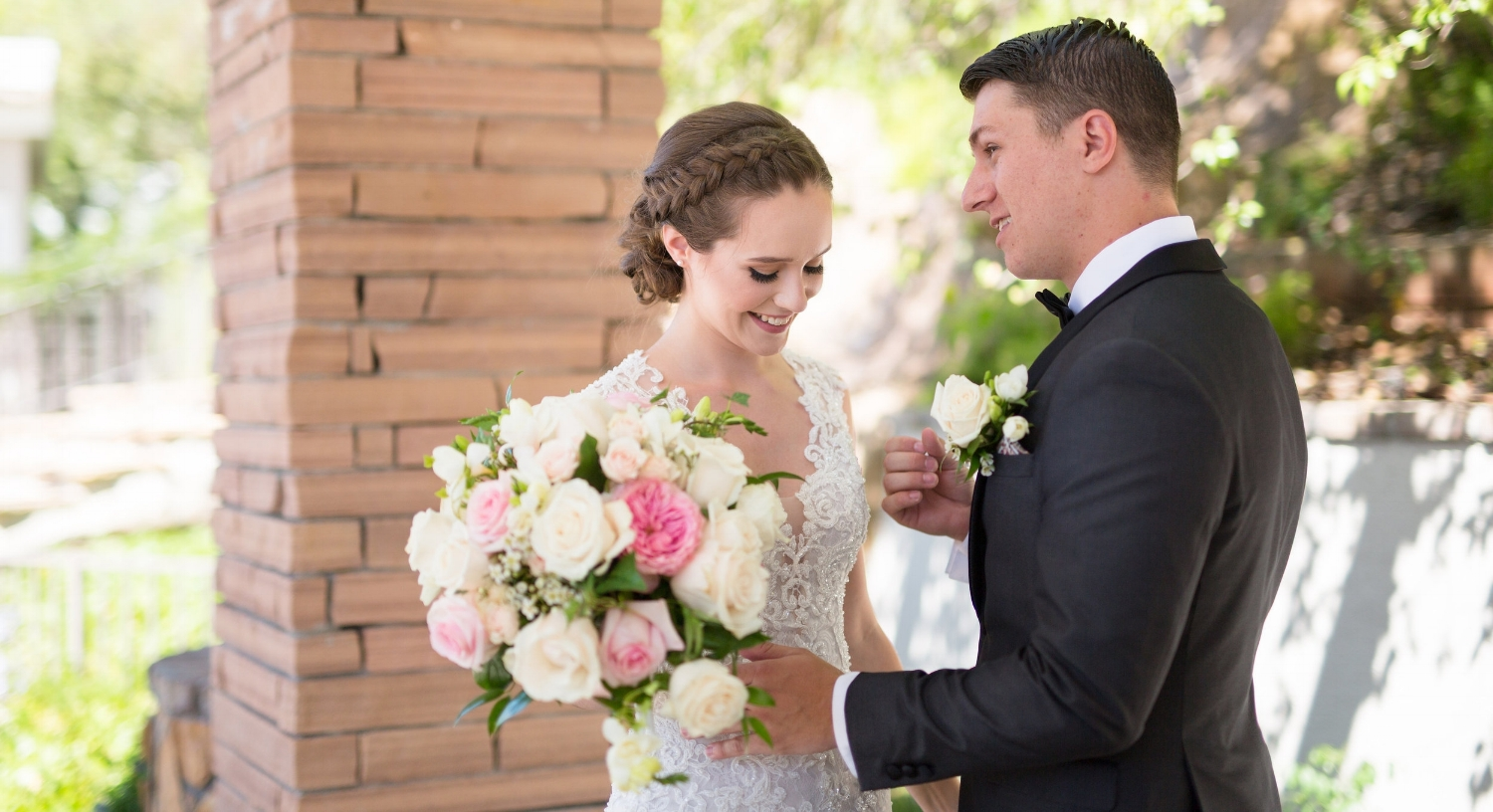 Young Brunette Bride with Natural Makeup, braided updo and bouqueton Wedding Day. Bridal Hair and Beauty by Vanity Belle in Orange County (Costa Mesa) and San Diego (La Jolla)