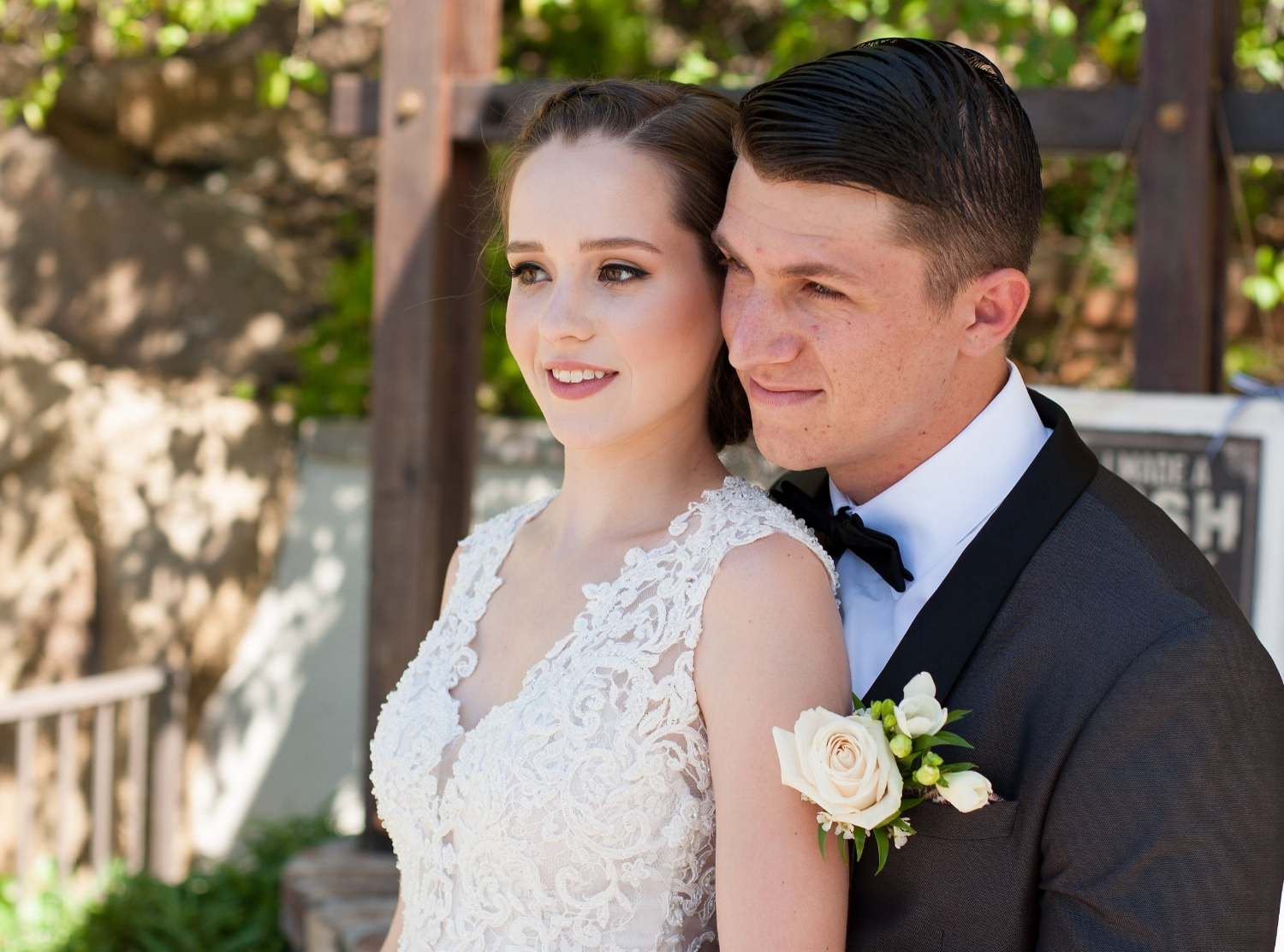 Wedding Day Photos of Young Brunette Bride with Natural Makeup and Braided Updo. Bridal Hair and Beauty by Vanity Belle in Orange County (Costa Mesa) and San Diego (La Jolla)