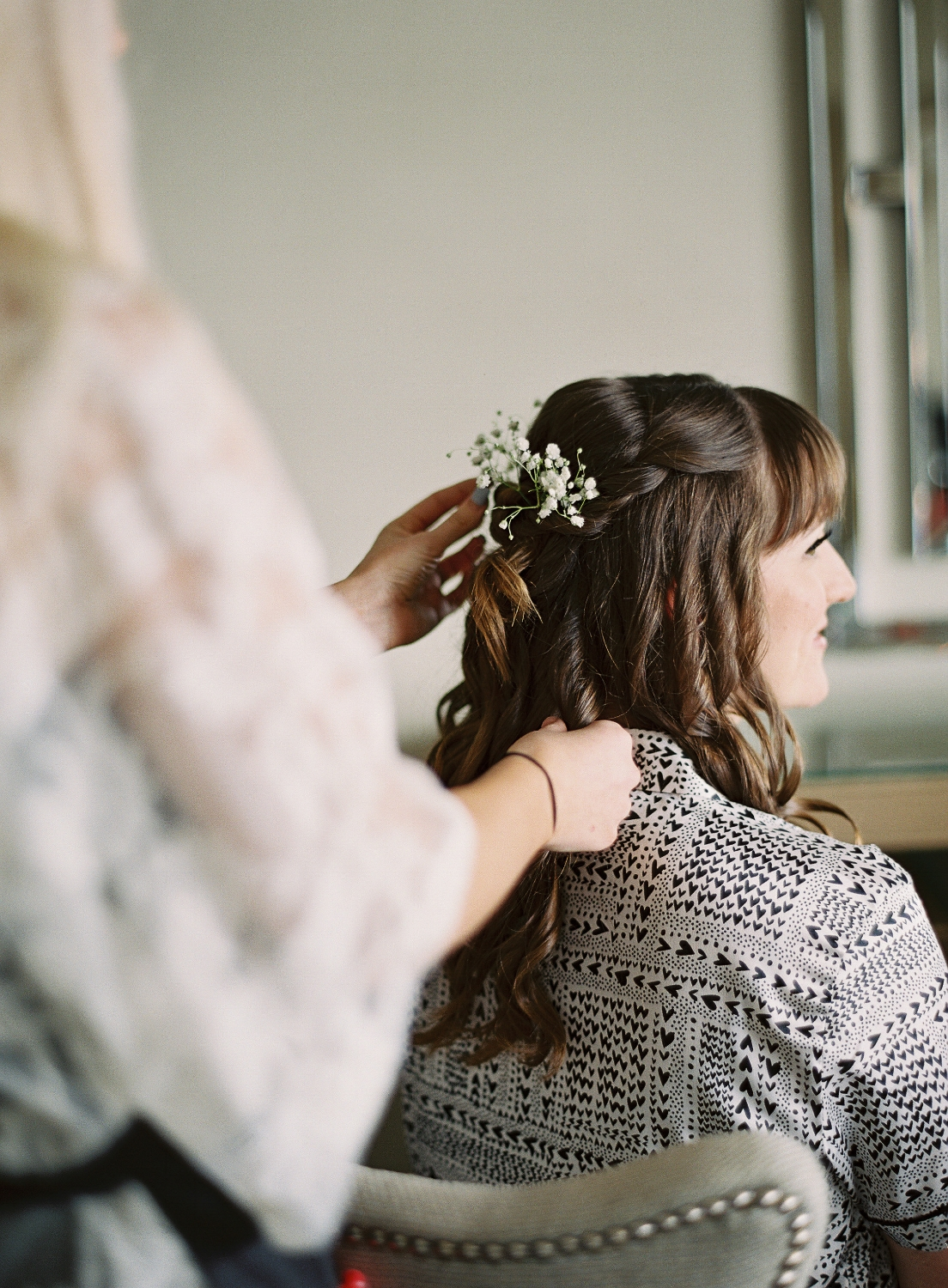 Brunette Bride with Curled Hairstyle Down, bangs and flowers in hair. Wedding makeup and hair by Vanity Belle in Orange County (Costa Mesa) and San Diego (La Jolla)