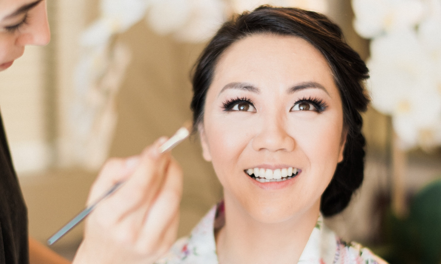 Asian Bride Morning of Wedding with Simple Makeup and Eyeliner in Floral Robe. Bridal Hair and Makeup by Vanity Belle in Orange County (Costa Mesa) and San Diego (La Jolla)