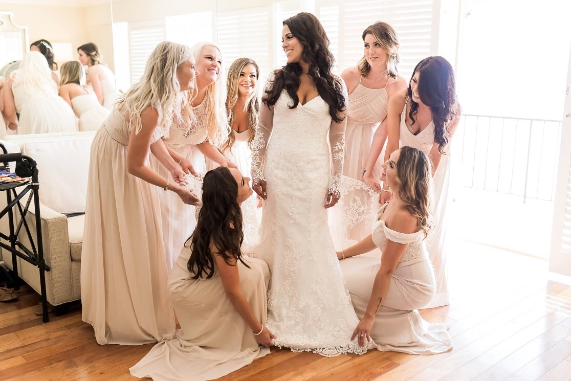 Bride photography on morning of wedding with bridesmaids dresses. Bridal Hair and Makeup Vanity Belle in Orange County (Costa Mesa) and San Diego (La Jolla)