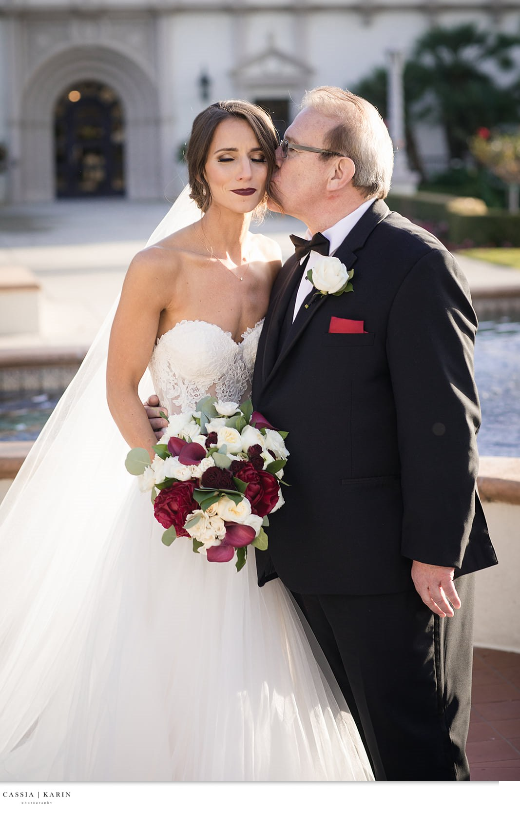 Brunette bride with side up-do in veil and bold lip. Bride with Father of the Bride. Bridal Beauty by Vanity Belle in Orange County (Costa Mesa) and San Diego (La Jolla). thevanitybelle.com