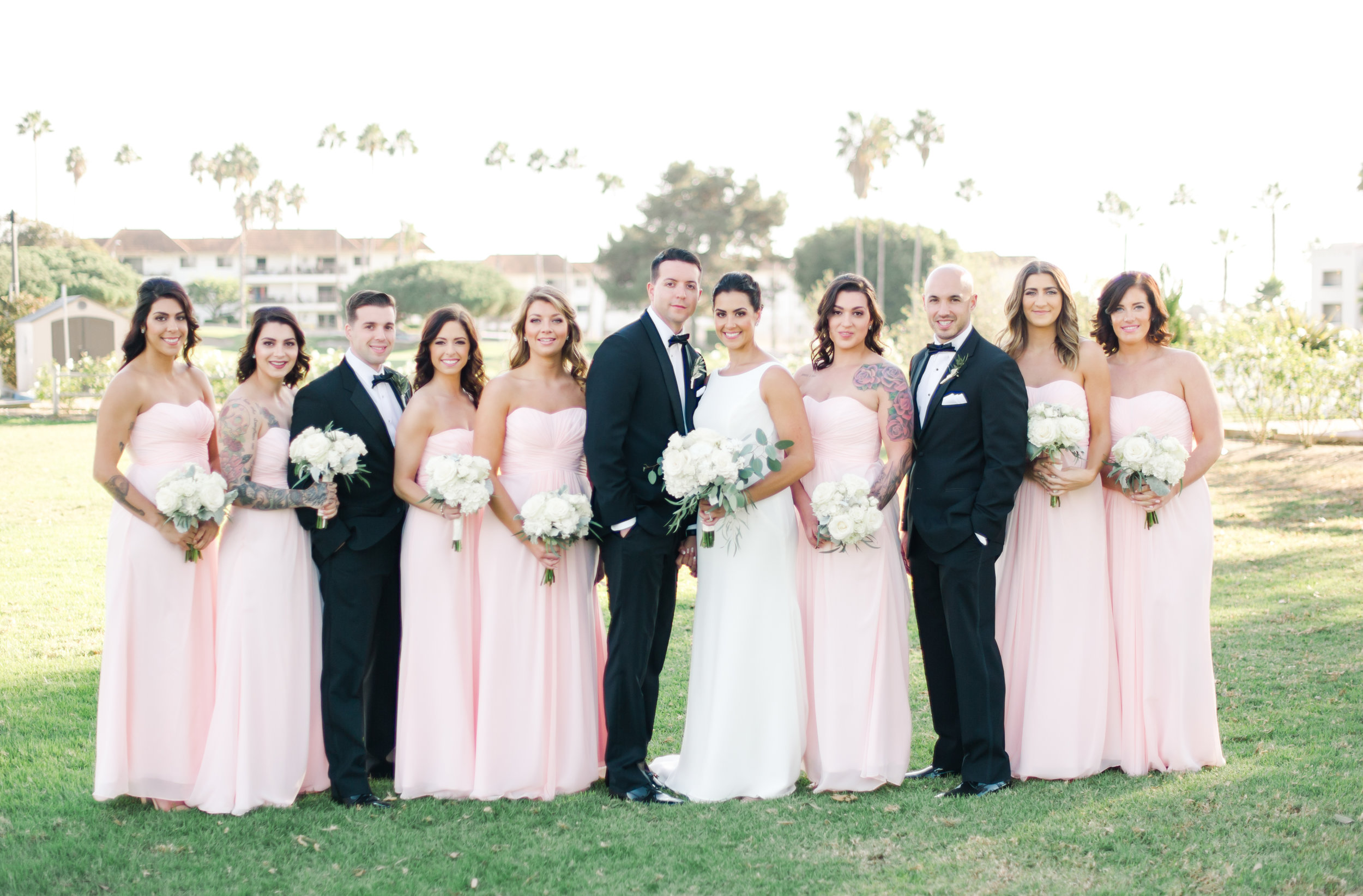 Bride, groom and bridal party portrait during outdoor wedding in San Clemente captured by Taryn Grey Photography. Bridal hair and makeup by Vanity Belle in Orange County (Costa Mesa) and San Diego (La Jolla) thevanitybelle.com