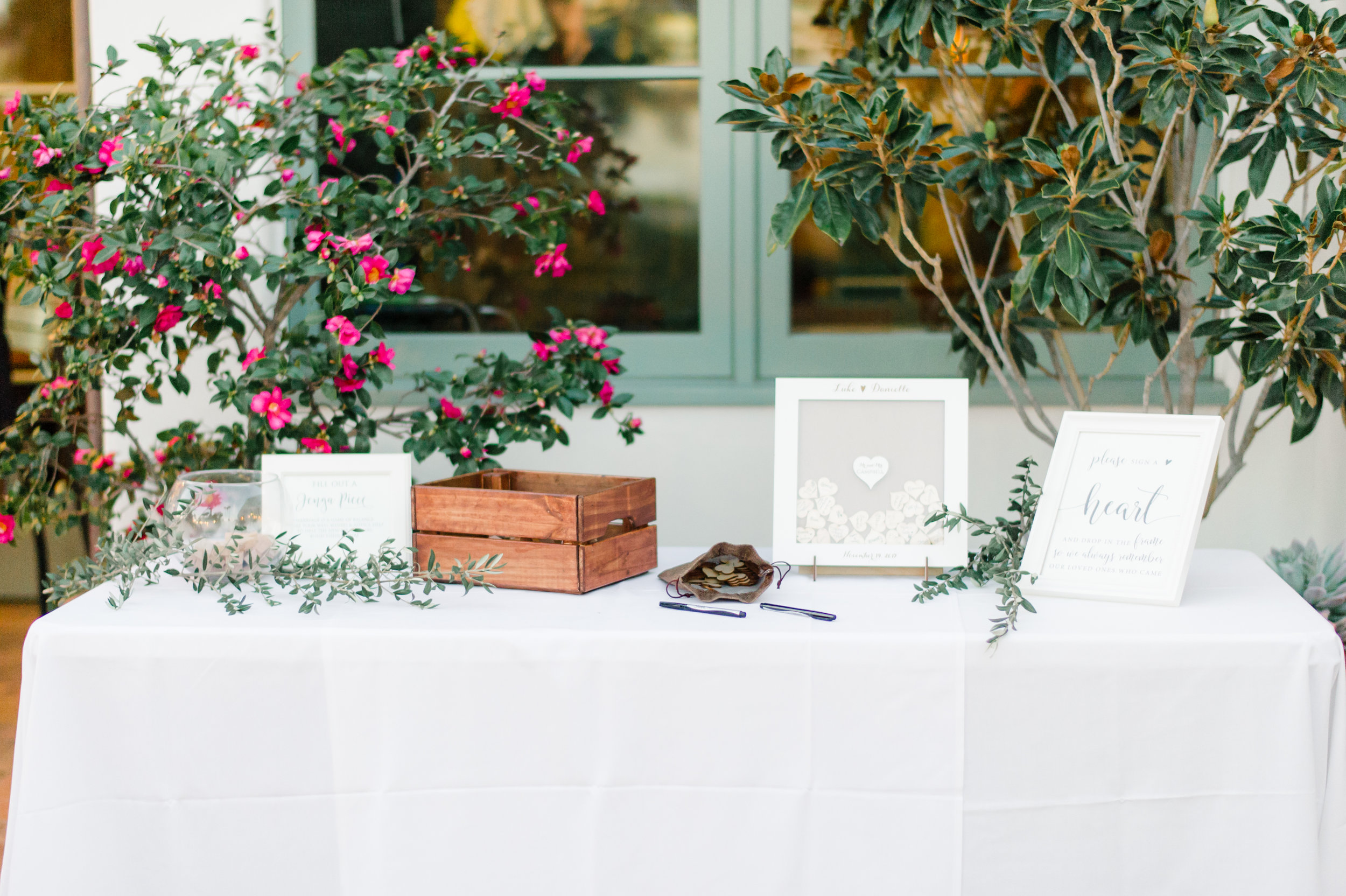 Unique guest book ideas during wedding reception captured by Taryn Grey Photography. Bridal hair and makeup by Vanity Belle in Orange County (Costa Mesa) and San Diego (La Jolla) thevanitybelle.com