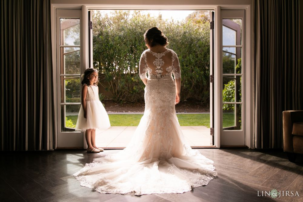 Bride with flower girl private moment   captured by Lin and Jirsa Photography. Wedding Day hair and makeup by Vanity Belle in Orange County (Costa Mesa) and San Diego (La Jolla) thevanitybelle.com