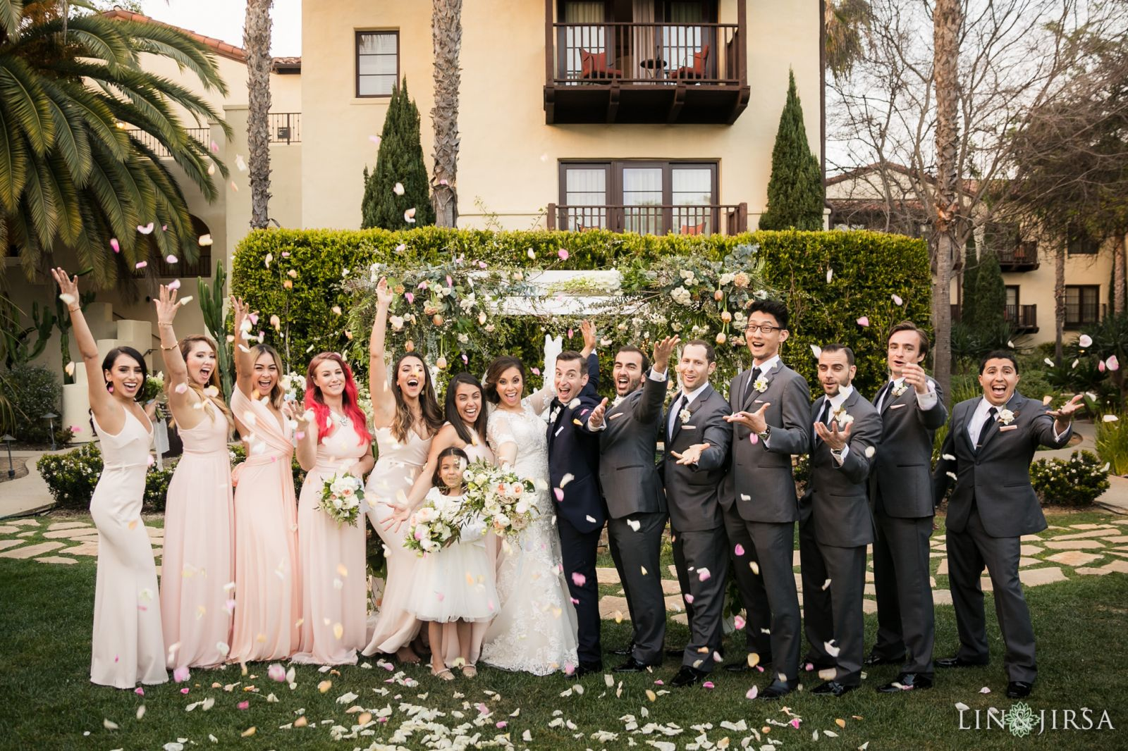 Bridal party photo fun tossing rose petals   at the Estancia Hotel in La Jolla. Bridal Beauty by Vanity Belle in Orange County (Costa Mesa) and San Diego (La Jolla) thevanitybelle.com. Photography by Lin and Jirsa.