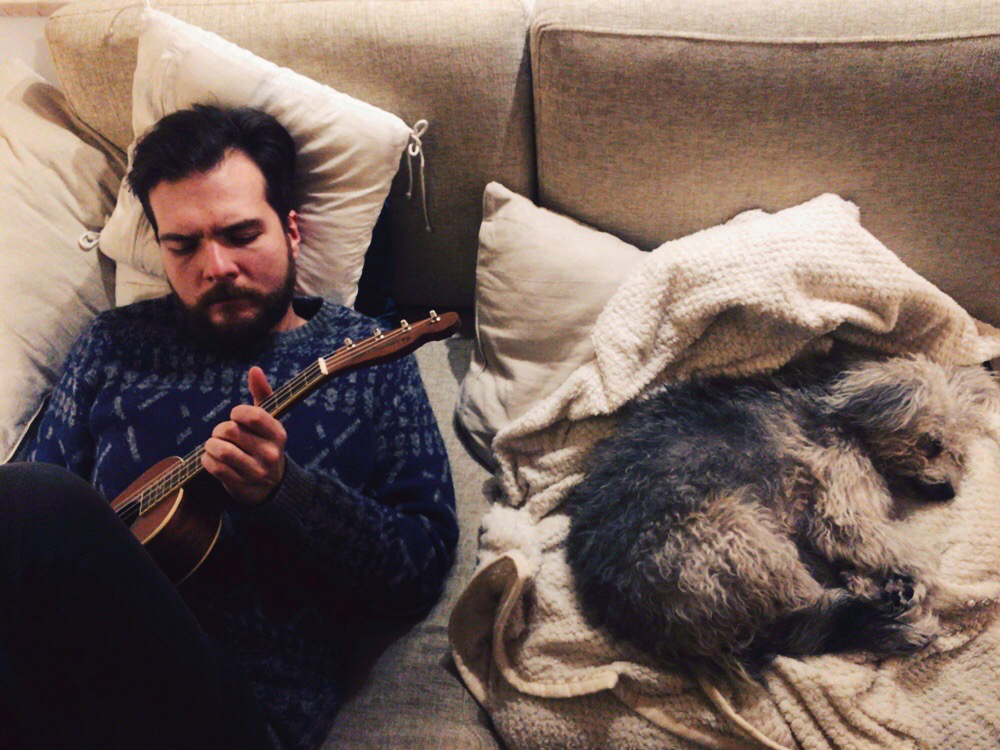Playing sad ukulele songs for my dog, cause I don't know any happy ones