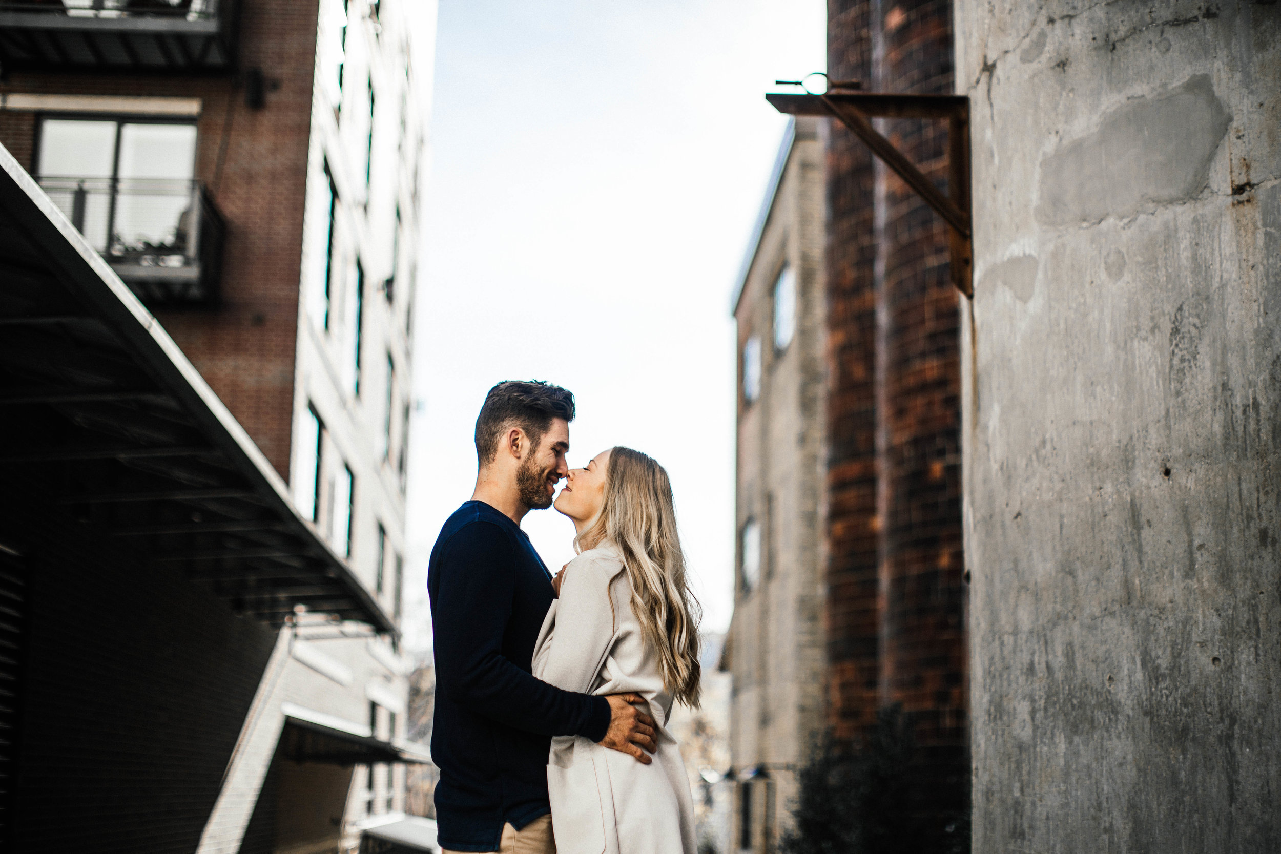 Minneapolis engaged couple kissing in Northeast