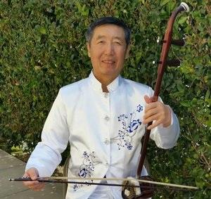王铁兵:   高胡演奏家。美中华人音乐家协会理事。