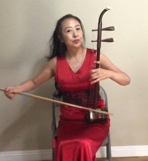 徐风:   中胡演奏家。美中华人音乐家协会理事。