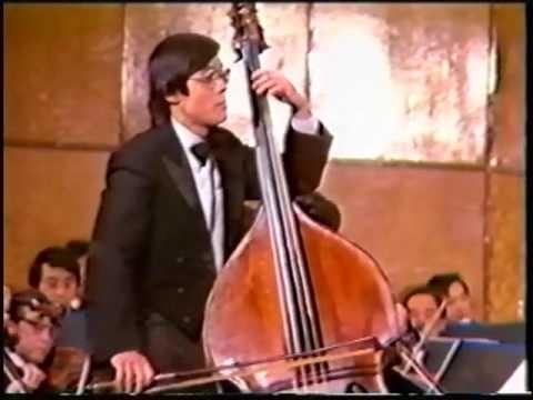 李愔:   著名低音提琴演奏家。美国梅拉诺文化演艺公司总裁。美国中华国乐团创办人。美中华人音乐家协会创会会长。