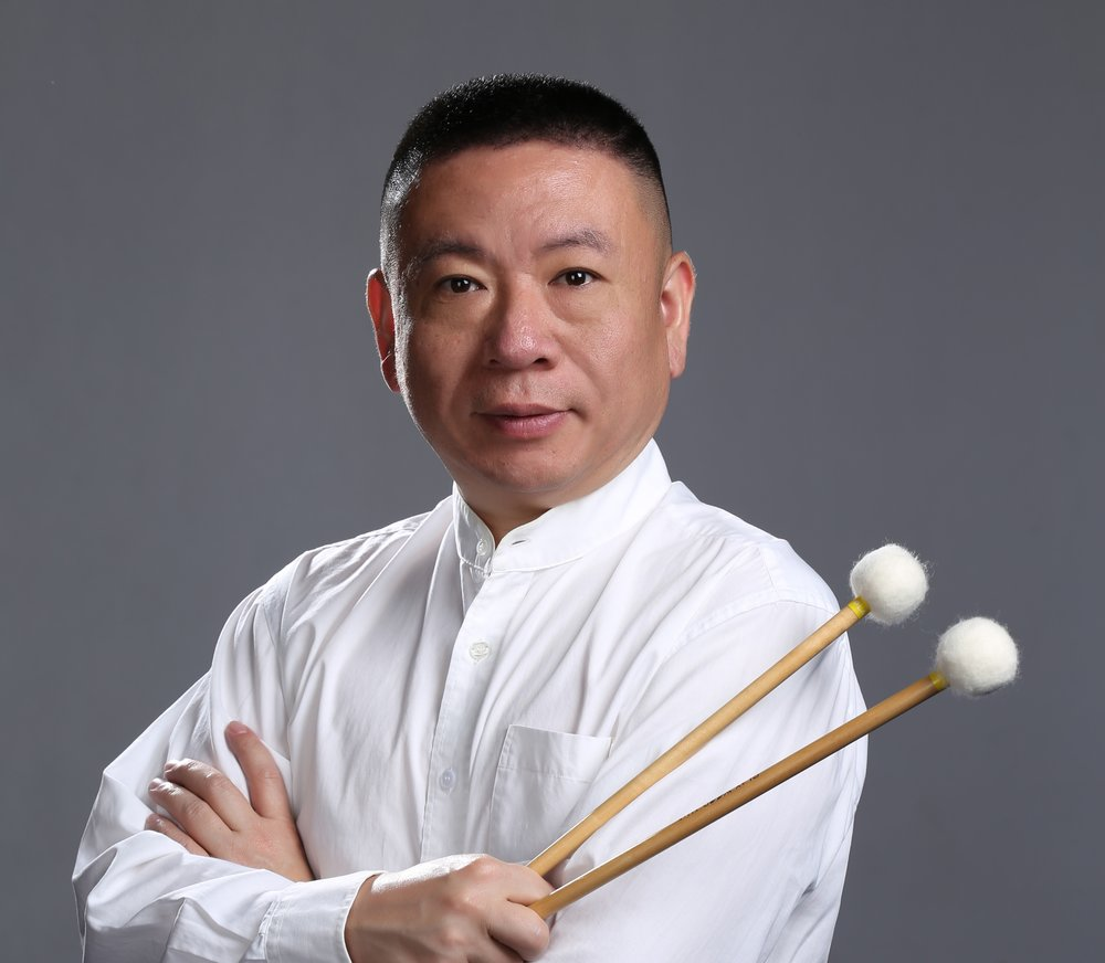 周乐嘉:中国著名国家一级打击乐演奏家,上海民族乐团打击乐首席,   美中华人音乐家协会理事