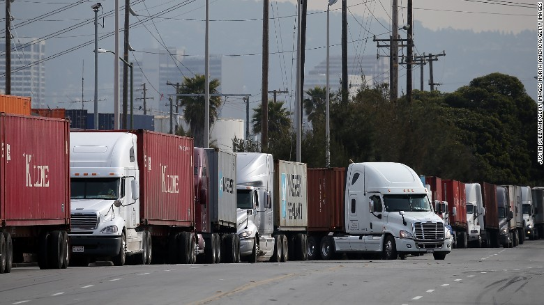 Trucks line up to make deliveries in Oakland, California.