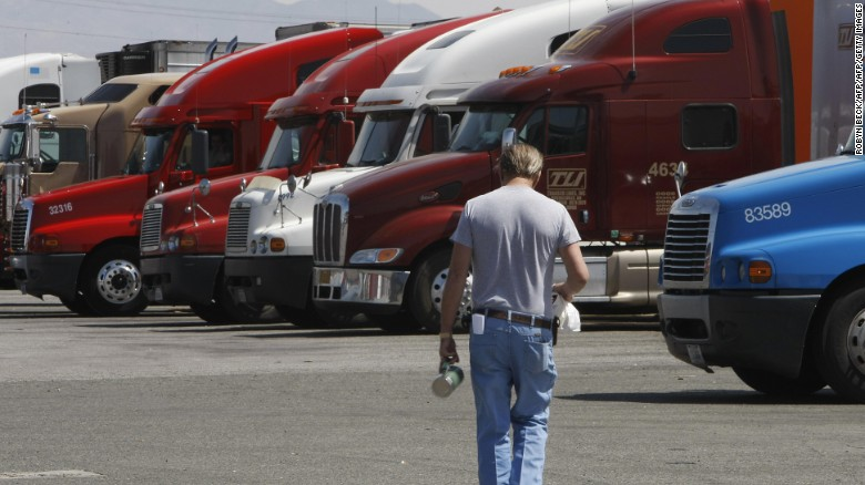 A trucker walks back to his truck at a truck stop in Oak Hills, California.