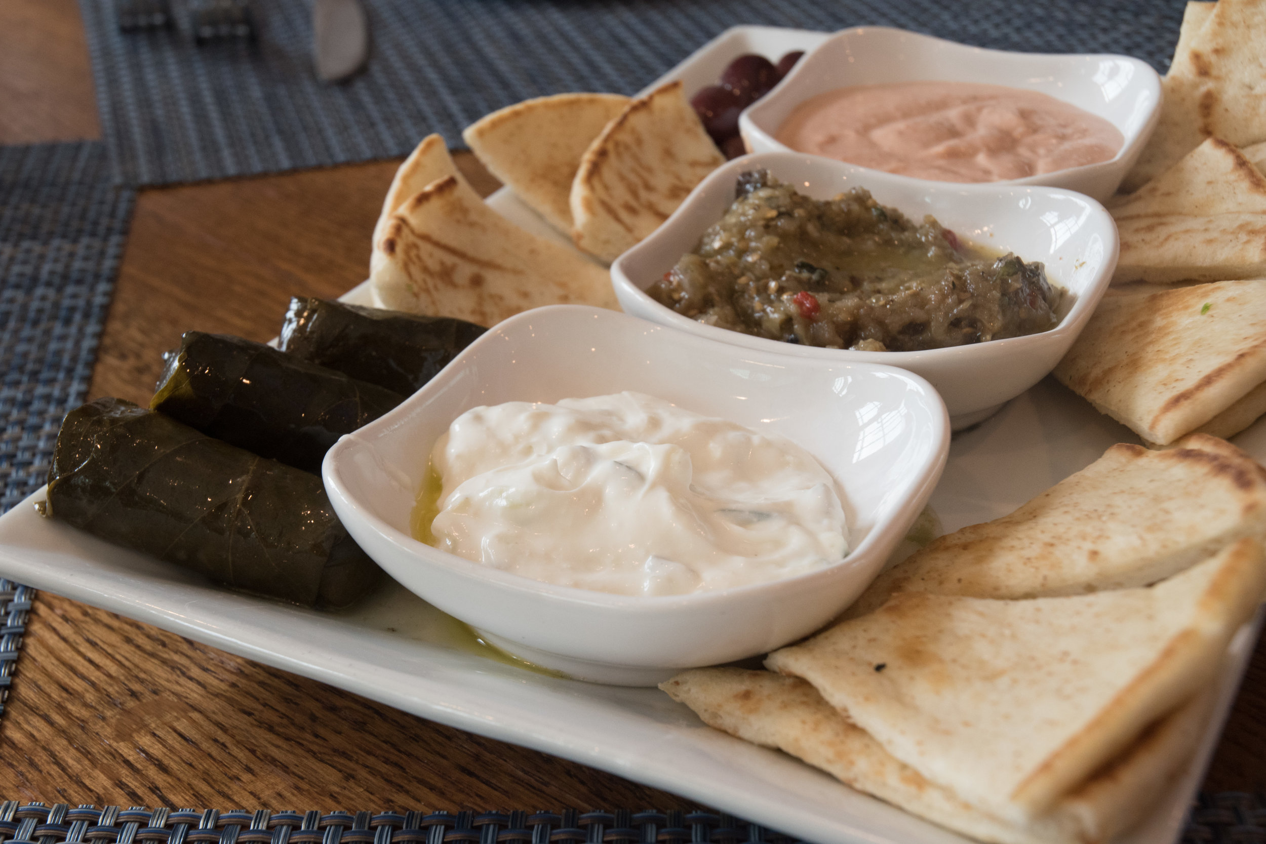 Dips from closest to farthest: tzatziki, melitzanosalata and taramasalata
