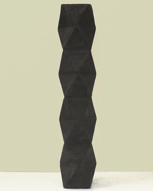 Slender X-form . Black basalt . Objects for the sophisticated eye. . Dust London. . #concreteorigamists #concretelife #showroom #minimalinterior #minimalhomeware #concretehouse #interiordesign #archiproducts #minimalist #seekthesimplicity #beautifulmatters #casting #concretejungle #concretesculpture #madebyhand #madeinlondon #madeinengland #londoncraftweek2017 #dustlondon