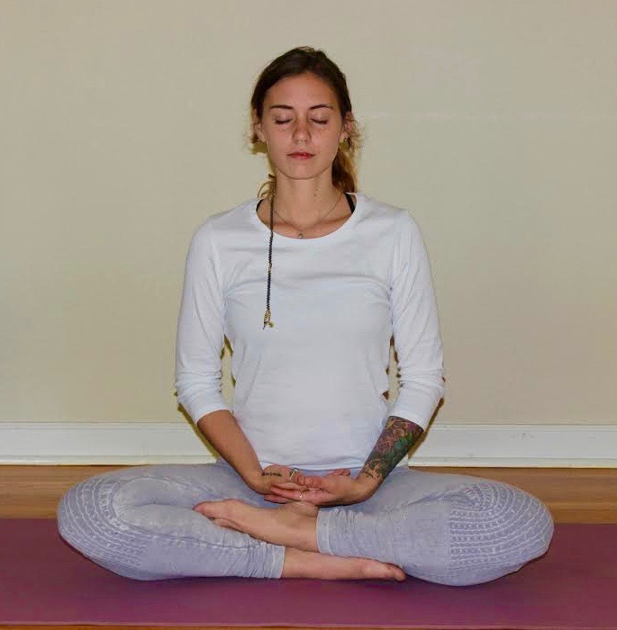 Start by sitting in quiet meditation, becoming mindful of your breath and the stillness in your body.