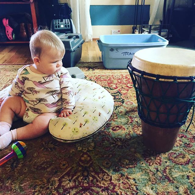 """""""Oh yea? You think I can't play that thing? I'm gonna fricken kill it at the Ocf drum tower this year...move over hippies."""" #babydrummer #hippiekid #staredown #baby #drummer"""