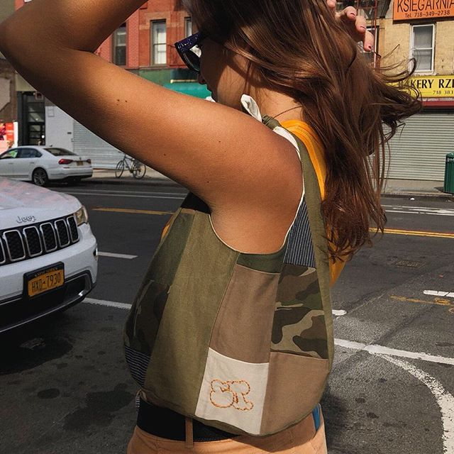 Caroline in the new shoulder bag 🌟 coming soon 💫 and the puzzle tank in orange 🍊