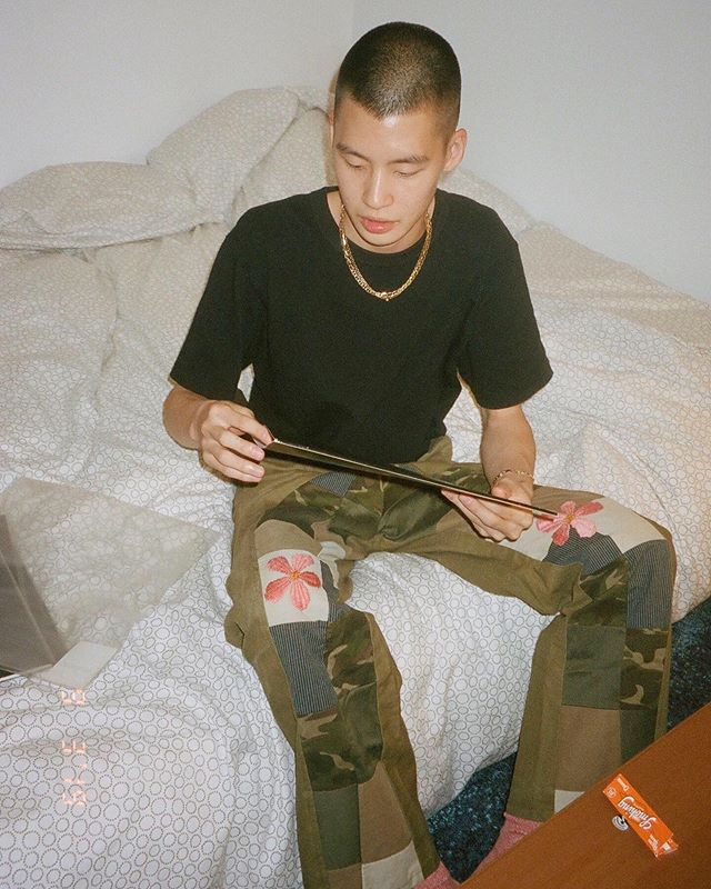 Jay in his Reworked Patchwork Pants with custom 🌸 pink 🌸 embroidery