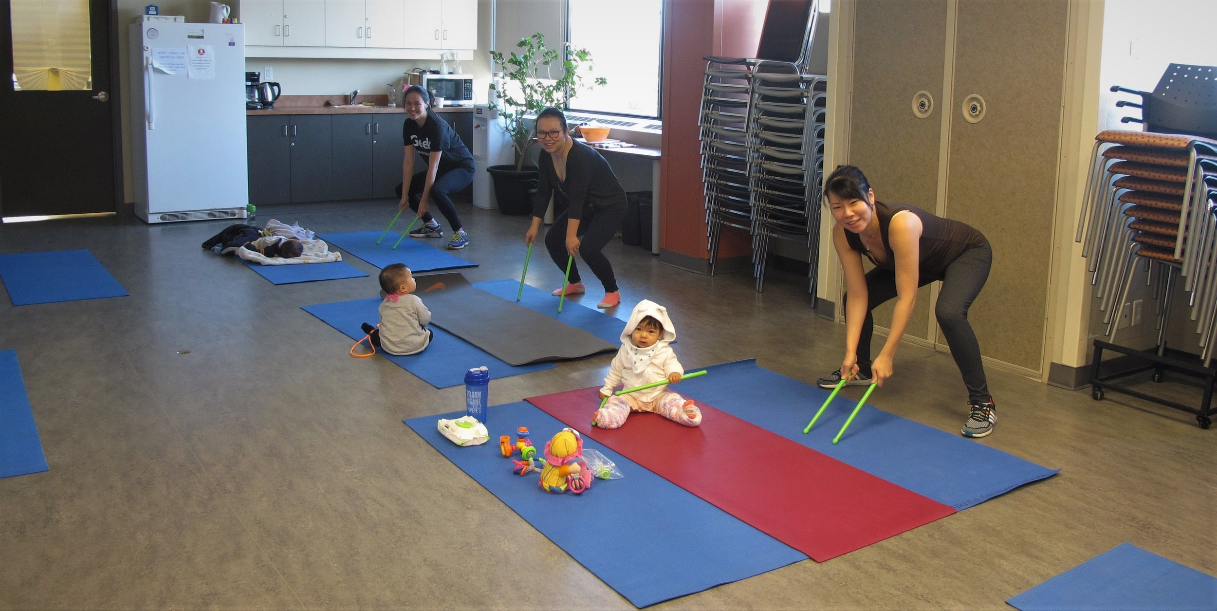 Having fun with the Women at the Mom and Baby Pound Fitness Class