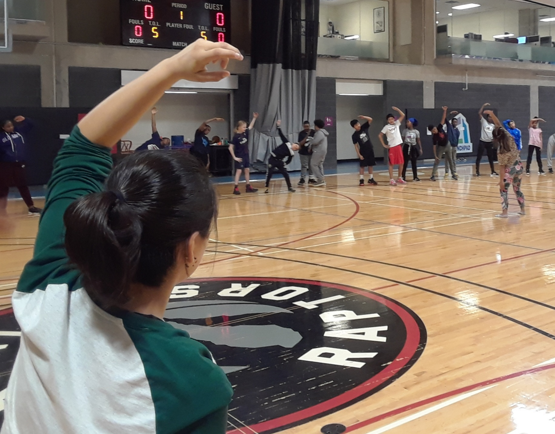stretching with the kids after the Latin HipHop Dance class @ the MLSE Launchpad