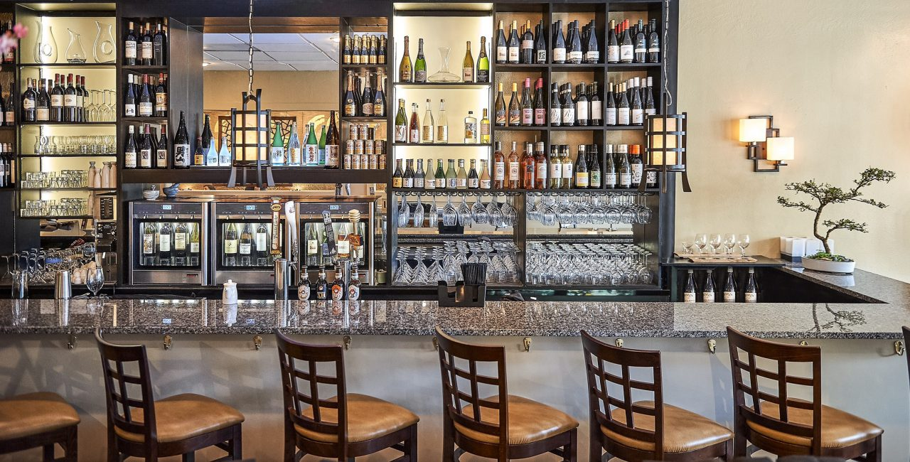 Quattro-model-behind-the-bar-with-12-bottles.jpg