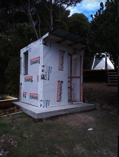 The building paper went on quickly and then we had to source the cladding.