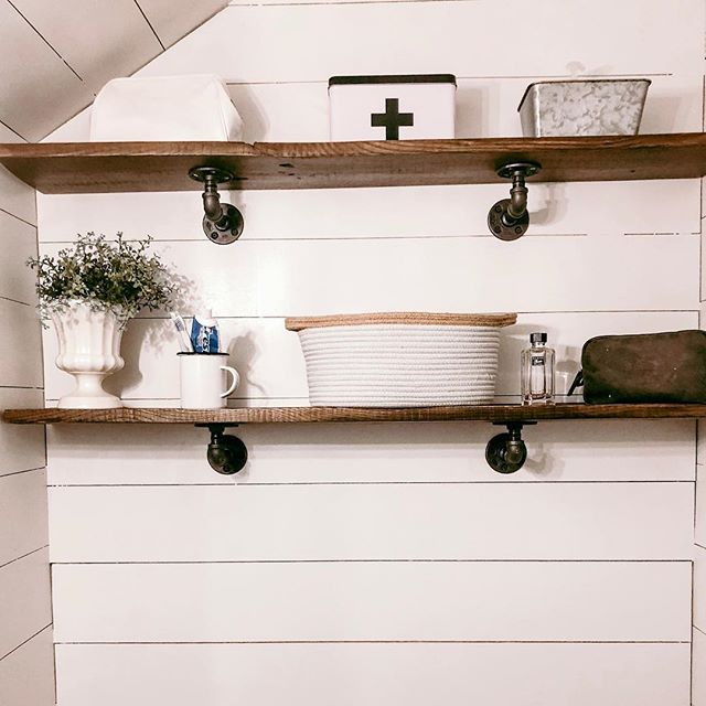 Oh the bathroom shelves are up and I'm loving it!! I found a galvanized bin at @michaelsstores that isn't shown here but it's 🙌🏻