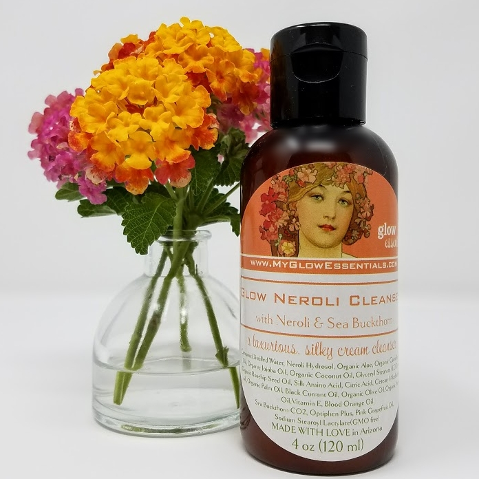 Glow Neroli Cleanser - This mild, silky cream cleanser leaves the skin feeling soft and smooth. Featuring neroli hydrosol (floral waters) and organic sea buckthorn, this is a gentle cleanser which removes impurities while nourishing and protecting the skin. It is made with all natural, botanical ingredients and has a refreshing, fruity floral scent. Formulated with a rich blend of fatty acids, silk peptides and powerful antioxidants, this creamy cleanser will leave your skin glowing and hydrated.