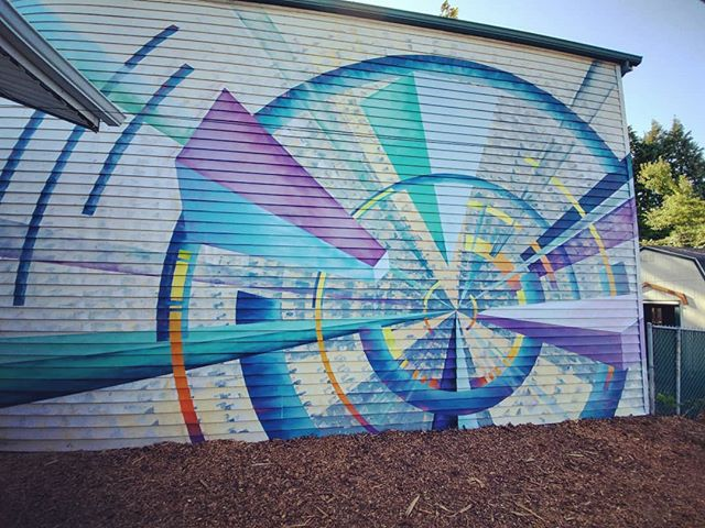 "Tha Tha That's all folks 💦 . . .  My biggest personal mural to date! This one had some unique challenges. A tight budget which called for a simple design. Simple doesn't always mean easy though as I found out. The siding was a huge technical challenge to get straight lines across as well as the ""perfect"" circle arches. Up and down and up and down my 18ft ladder. Another technical challenge was vinyl siding. I had to come up with a new color palette on the spot. If you use too many dark colors or latex paint with black colorant the vinyl siding will warp and pull itself away. This lead to lighter colors. I used some darker colors sparingly. The color palette forced me to really focus on my perspective and arrangements for depth. .. . I am excited to come back. Were treating this as an ever evolving mural. Next year I will come back and add more details and forms. . .. Be Most Excellent!"