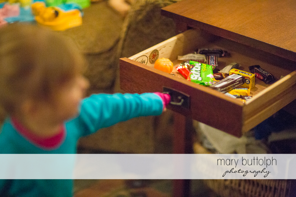 Girl opening a drawer full of Halloween candies at Skaneateles