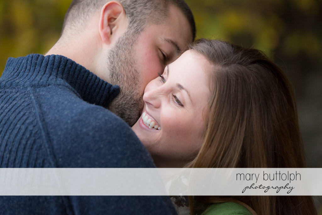 Couple share a happy moment at Skaneateles Engagement