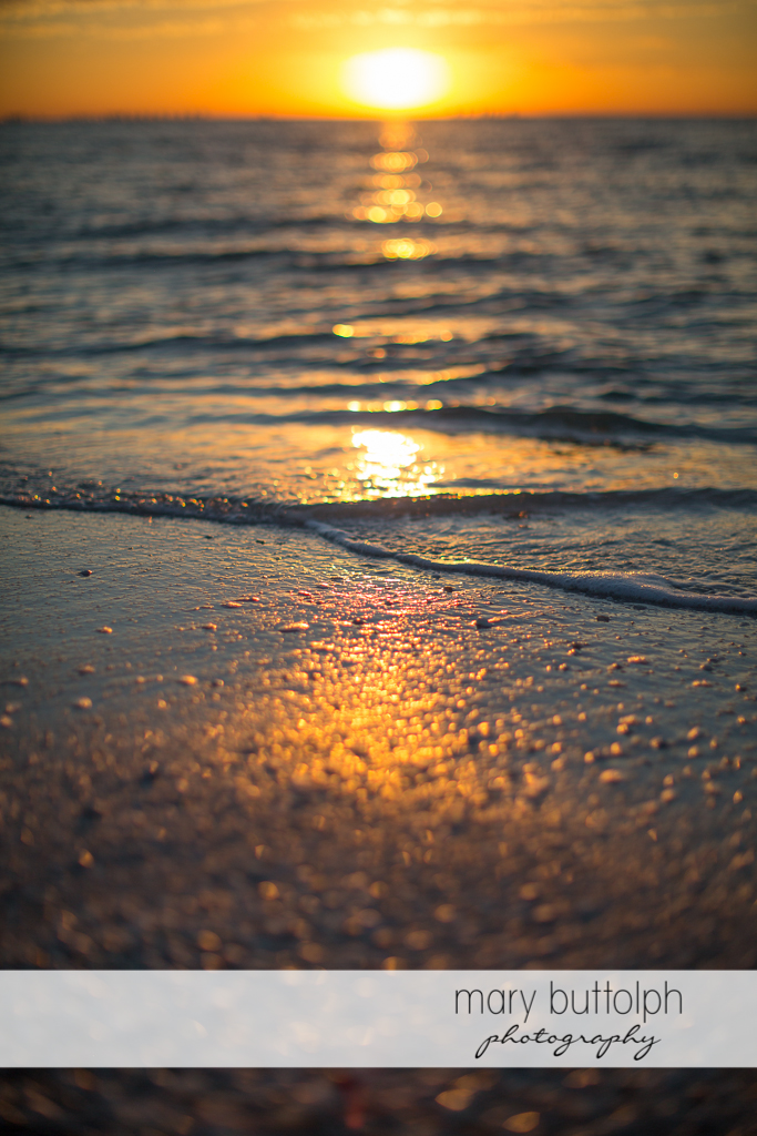 The sun sets on the horizon at Sanibel Island Vacation