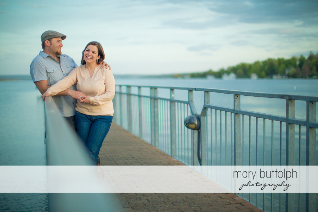 Couple enjoy the view from the dock at Skaneateles Engagement