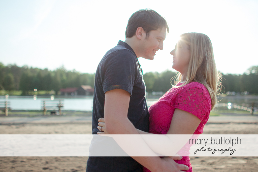 Couple pose in front of the lake at Green Lakes State Park Engagement