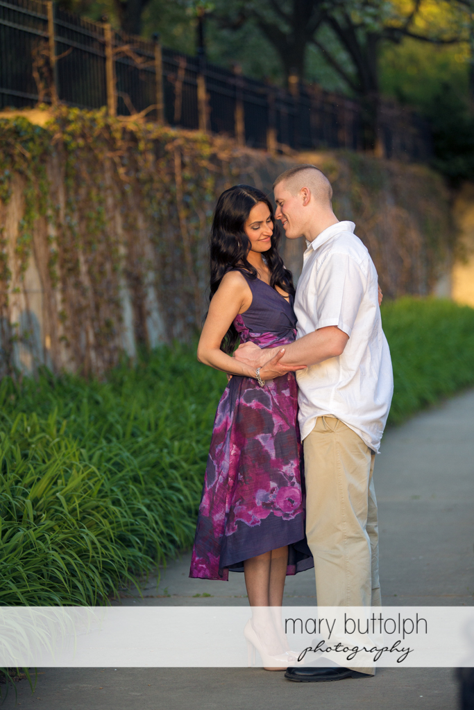 Couple pose on the walkway at Franklin Square Engagement