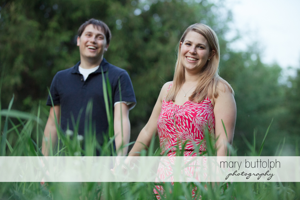 Couple stroll in the woods at Green Lakes State Park Engagement