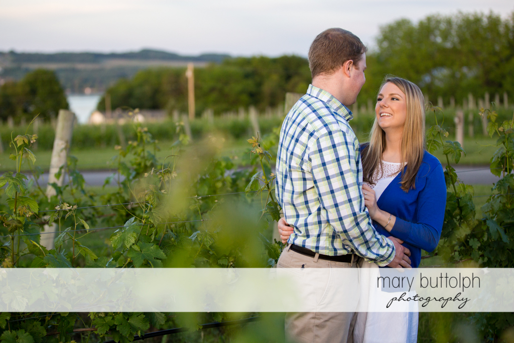 Couple get romantic in the field at Skaneateles Engagement